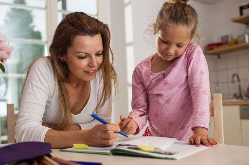 image showing kids learning at home with the guidance of their parents